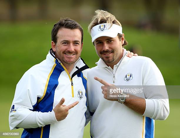 Graeme McDowell and Victor Dubuisson of Europe celebrate victory on the 14th green during the Afternoon Foursomes of the 2014 Ryder Cup on the PGA...