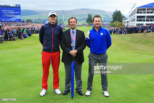 Graeme McDowell of Europe and Jordan Spieth of the United States pose with referee David Williams on the first tee during the Singles Matches of the...