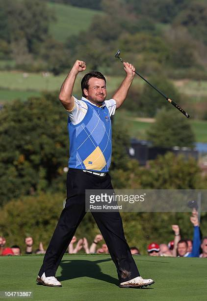 Graeme McDowell of Europe celebrates his 3&1 win to secure victory for the European team on the 17th green in the singles matches during the 2010...