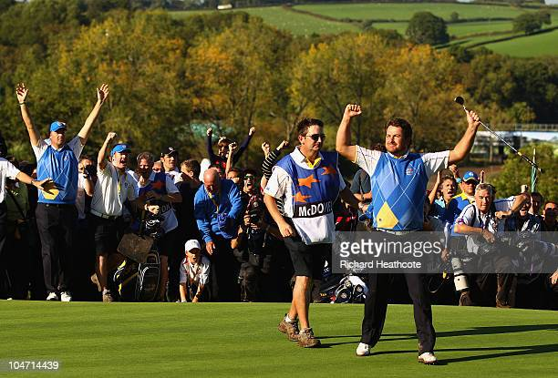 Graeme McDowell of Europe celebrates his 31 win to secure victory for the European team on the 17th green in the singles matches during the 2010...