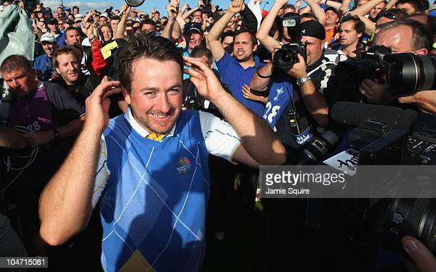 Graeme McDowell of Europe celebrates his 31 win to secure victory for the European team on the 17th green at the end of the singles matches during...