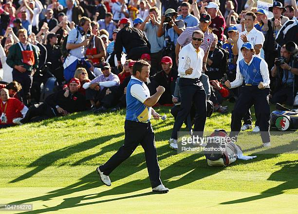 Graeme McDowell of Europe celebrates holing a putt on the 16th green in the singles matches during the 2010 Ryder Cup at the Celtic Manor Resort on...
