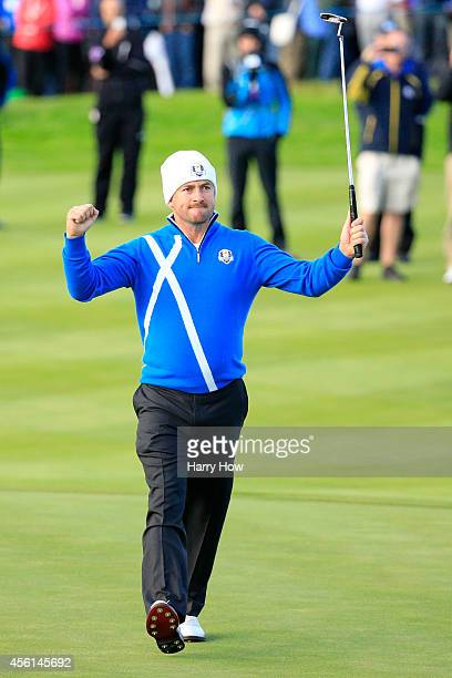 Graeme McDowell of Europe celebrates victory on the 16th hole during the Afternoon Foursomes of the 2014 Ryder Cup on the PGA Centenary course at the...