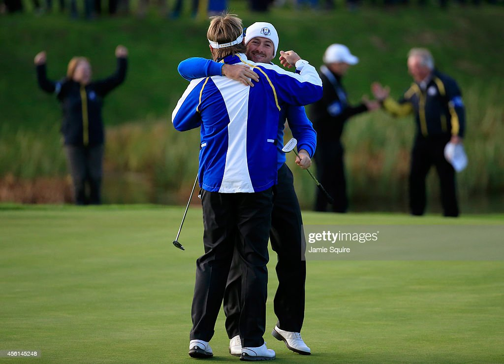 Graeme McDowell (R) of Europe celebrates victory with Victor Dubuisson of Europe on the 16th green during the Afternoon Foursomes of the 2014 Ryder Cup on the PGA Centenary course at the Gleneagles Hotel on September 26, 2014 in Auchterarder, Scotland.