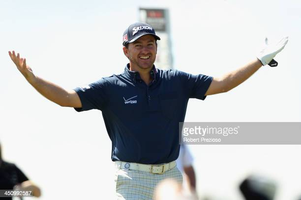 Graeme McDowell of Ireland celebrates after making his second shot on the 9th hole during day one of the World Cup of Golf at Royal Melbourne Golf...