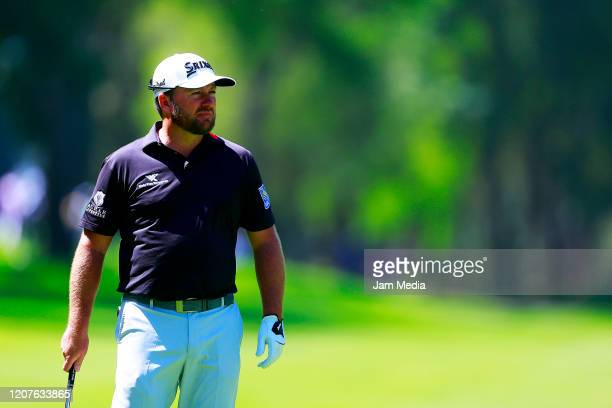 Graeme McDowell of Ireland plays his shot during the first round of the World Golf Championships Mexico Championship at Club de Golf Chapultepec on...