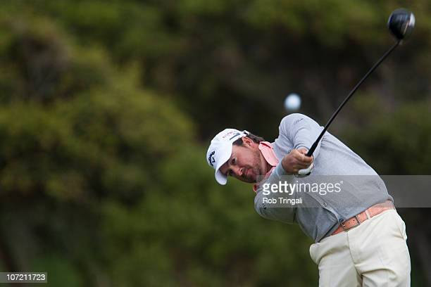 Graeme McDowell of Northern hits his drive on the 13th hole during the final round of the 110th US Open at Pebble Beach Golf Links on June 20 2010 in...