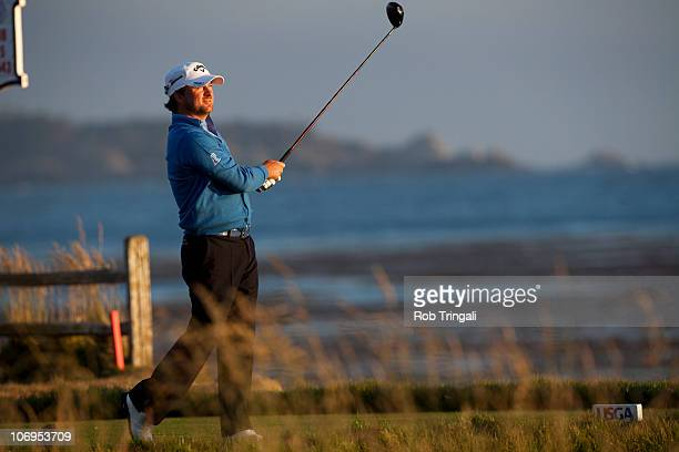 Graeme McDowell of Northern hits his tee shot on the 18th hole during third round of the 110th US Open at Pebble Beach Golf Links on June 19 2010 in...