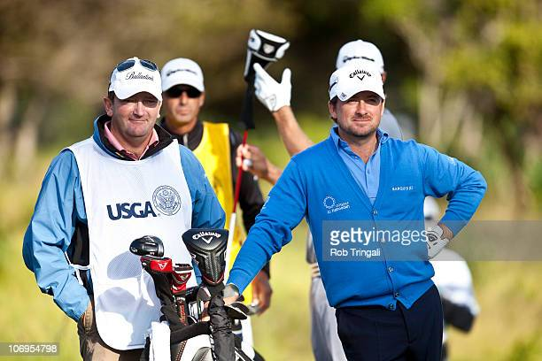 Graeme McDowell of Northern hits looks on with caddie Ken Comboy on the 13th hole during third round of the 110th US Open at Pebble Beach Golf Links...