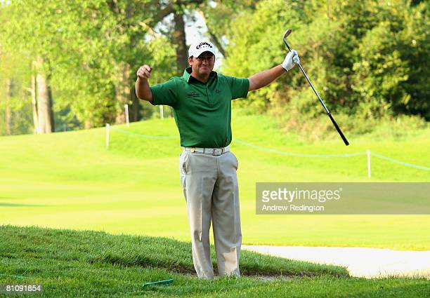 Graeme McDowell of Northern Ireland celebrates after holing a bunker shot on the 12th hole during the first round of the Irish Open on May 15 2008 at...