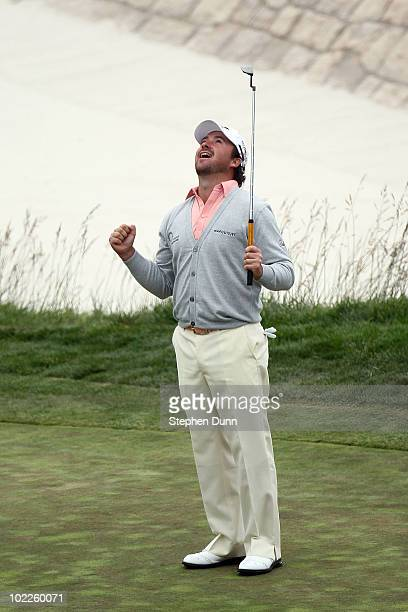 Graeme McDowell of Northern Ireland celebrates making par on the 18th hole to win the 110th U.S. Open at Pebble Beach Golf Links on June 20, 2010 in...