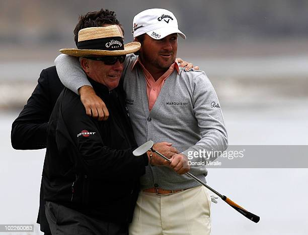 Graeme McDowell of Northern Ireland celebrates with his father Ken on the 18th green after winning the 110th US Open at Pebble Beach Golf Links on...