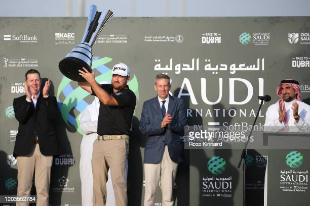 Graeme McDowell of Northern Ireland celebrates with the trophy during Day 4 of the Saudi International at Royal Greens Golf and Country Club on...