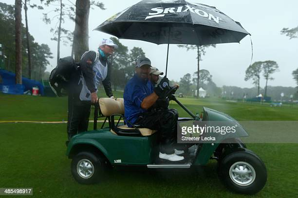 Graeme McDowell of Northern Ireland exits the course during a play suspension due to incliment weather during the second round of the RBC Heritage at...