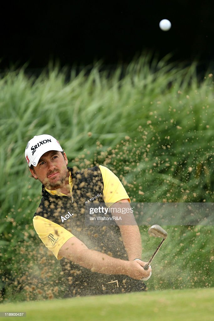 Graeme McDowell of Northern Ireland hits a bunker shot during the second practice round during The Open Championship at Royal St. George's on July 12, 2011 in Sandwich, England. The 140th Open begins on July 14, 2011.