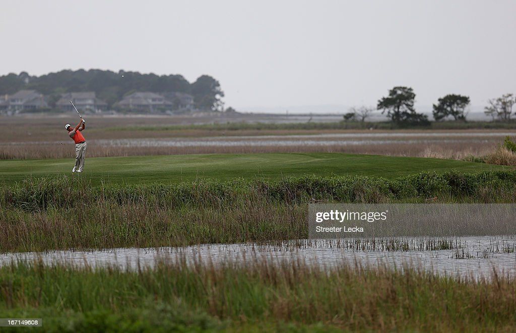 Graeme McDowell of Northern Ireland hits a shot from the 18th fairway in a playoff against Webb Simpson during the final round of the RBC Heritage at Harbour Town Golf Links on April 21, 2013 in Hilton Head Island, South Carolina.