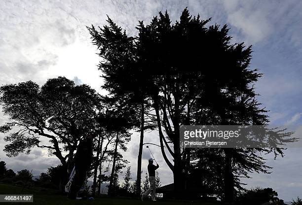 Graeme McDowell of Northern Ireland hits a tee shot on the 13th hole during a practice round for the ATT Pebble Beach National ProAm at Pebble Beach...