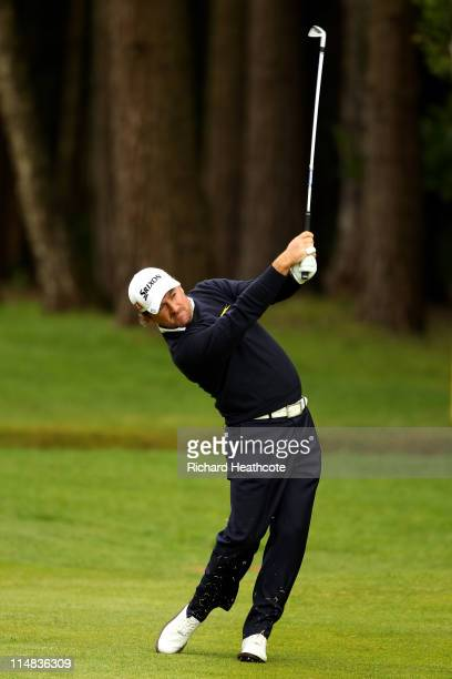 Graeme McDowell of Northern Ireland hits an approach shot on the 12th hole during the second round of the BMW PGA Championship at the Wentworth Club...