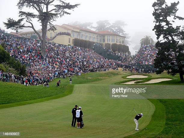 Graeme McDowell of Northern Ireland hits his approach shot on the 18th hole during the final round of the 112th U.S. Open at The Olympic Club on June...
