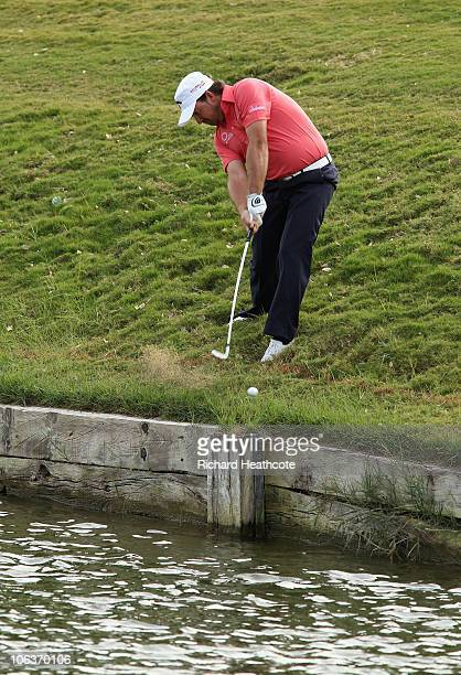 Graeme McDowell of Northern Ireland hits his approach to the 10th green from the hazard during the third round of the Andalucia Valderrama Masters at...