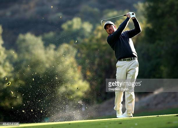 Graeme McDowell of Northern Ireland hits his second shot on the 18th hole during the second round of the Northwestern Mutual World Challenge at...