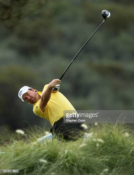 Graeme McDowell of Northern Ireland hits his tee shot on the 12th hole during round two of the Chevron World Challenge at Sherwood Country Club on...