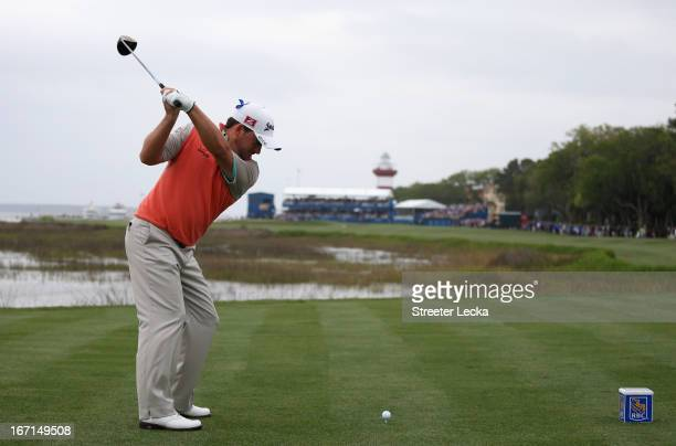 Graeme McDowell of Northern Ireland hits his tee shot on the 18th hole during a playoff with Webb Simpson in the final round of the RBC Heritage at...