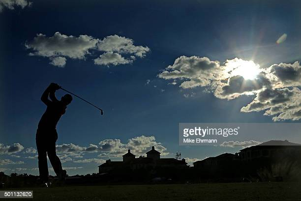 Graeme McDowell of Northern Ireland hits his tee shot on the 18th hole during the final round of the Franklin Templeton Shootout at Tiburon Golf Club...