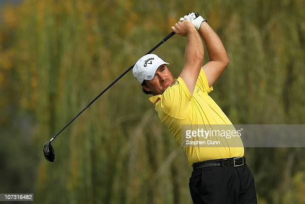Graeme McDowell of Northern Ireland hits his tee shot on the fifth hole during round two of the Chevron World Challenge at Sherwood Country Club on...