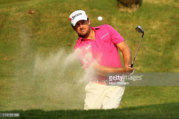 Graeme McDowell of Northern Ireland holes out of a bunker on the sixth hole for birdie during the first round of THE PLAYERS Championship held at THE...