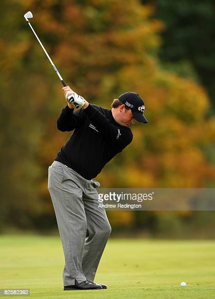 Graeme McDowell of Northern Ireland Ireland hits his second shot on the 15th hole during the first round of The Johnnie Walker Championship at...