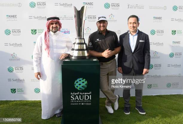Graeme McDowell of Northern Ireland is presented the trophy during Day 4 of the Saudi International at Royal Greens Golf and Country Club on February...