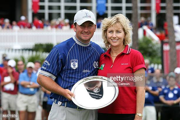 Graeme McDowell of Northern Ireland is presented with the Payne Stewart Salver Award for the best individual score by Payne's wife Tracy Stewart...