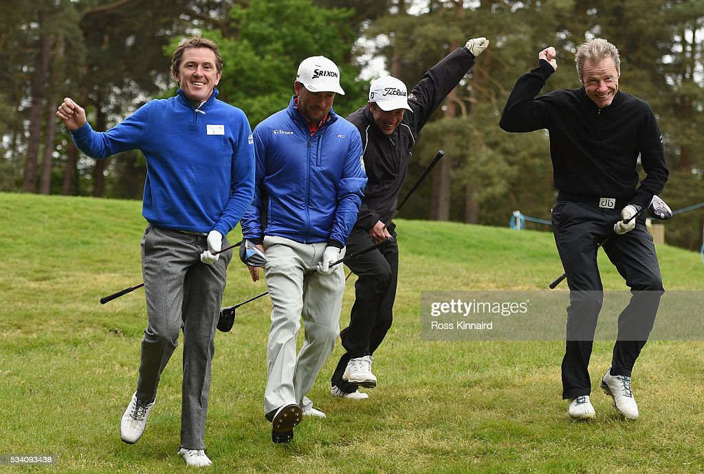Graeme McDowell of Northern Ireland jokes around with Jockeys Sir Anthony McCoy (L), Carl Llewellyn and Mick Fiztgerald (R) during the Pro-Am prior to the BMW PGA Championship at Wentworth on May 25, 2016 in Virginia Water, England.