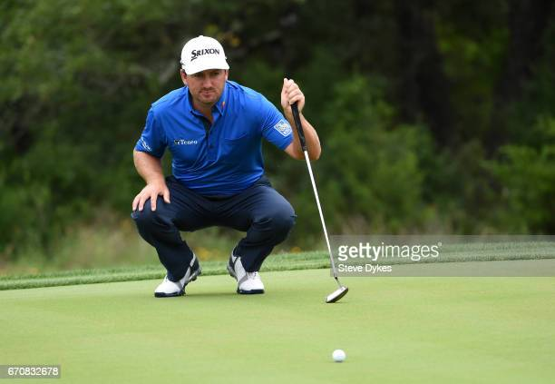 Graeme McDowell of Northern Ireland lines up a putt during the first round of the Valero Texas Open at TPC San Antonio ATT Oaks Course on April 20...