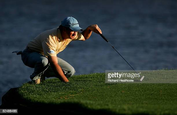 Graeme McDowell of Northern Ireland lines up a putt on the 17th green during the final round of The Players Championship at the TPC at Sawgrass on...