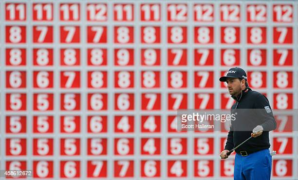 Graeme McDowell of Northern Ireland lines up a putt the 18th green during the third round of the WGC HSBC Champions at the Sheshan International Golf...