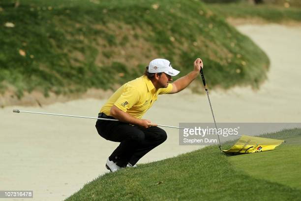 Graeme McDowell of Northern Ireland lines up his putt on the fourth hole during round two of the Chevron World Challenge at Sherwood Country Club on...