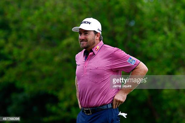 Graeme McDowell of Northern Ireland looks on before hitting his first shot on the 2nd hole during the final round of the OHL Classic at the Mayakoba...