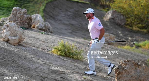 Graeme McDowell of Northern Ireland on the 18th hole during the third round of the Saudi International at Royal Greens Golf and Country Club on...