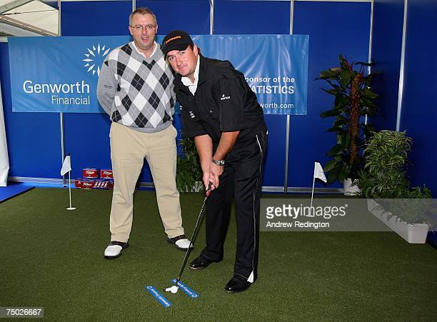 Graeme McDowell of Northern Ireland opens the Genworth putting facility in the tented village as Bob Brannock CEO of Genworth looks on prior to the...