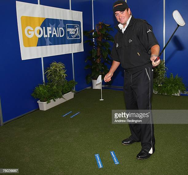 Graeme McDowell of Northern Ireland opens the Genworth putting facility in the tented village prior to the ProAm for the Smurfit Kappa European Open...