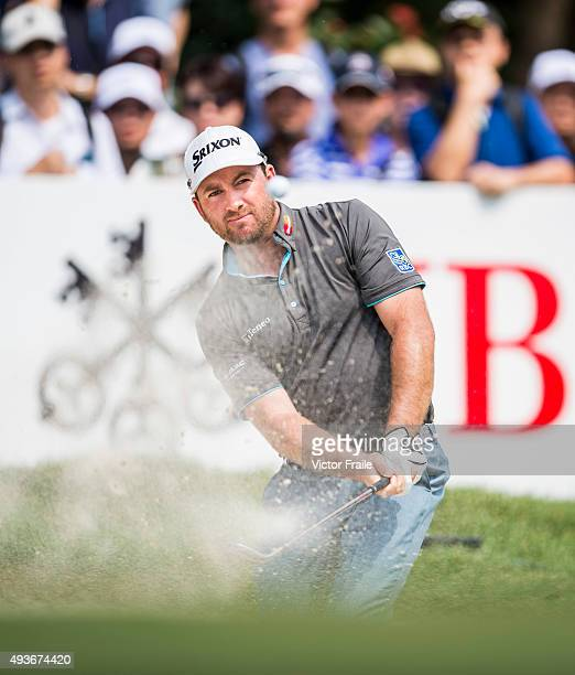 Graeme Mcdowell of Northern Ireland plays a bunker shot on the 4th hole during the first round of the UBS Hong Kong Open at the Hong Kong Golf Club...