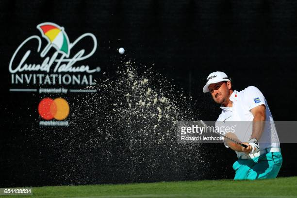 Graeme McDowell of Northern Ireland plays a shot from a bunker on the 17th hole during the second round of the Arnold Palmer Invitational Presented...