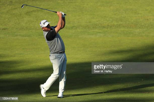 Graeme McDowell of Northern Ireland plays a shot on the 11th hole during the during the first round of the ATT Pebble Beach ProAm at Spyglass Hill...