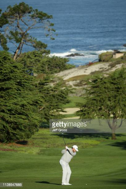 Graeme McDowell of Northern Ireland plays a shot on the first hole during the third round of the ATT Pebble Beach ProAm at Spyglass Hill Golf Course...