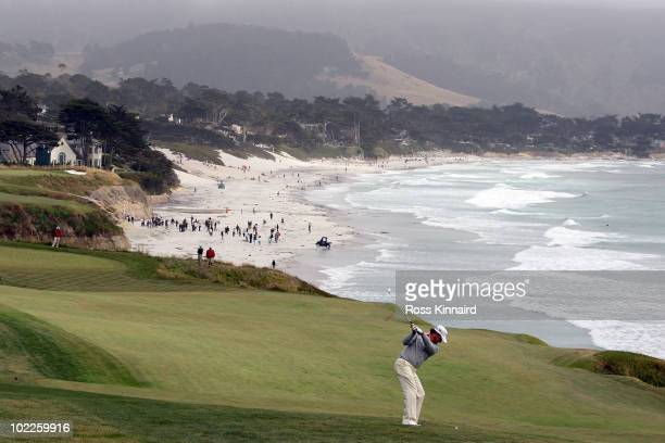 Graeme McDowell of Northern Ireland plays his approach shot on the ninth hole during the final round of the 110th US Open at Pebble Beach Golf Links...
