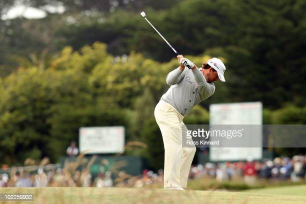 Graeme McDowell of Northern Ireland plays his approach shot on the 13th hole during the final round of the 110th US Open at Pebble Beach Golf Links...