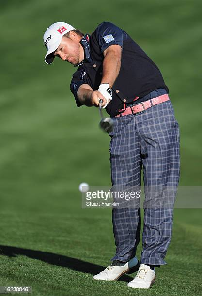 Graeme McDowell of Northern Ireland plays his approach shot on the second extra hole during the second round of the World Golf Championships...