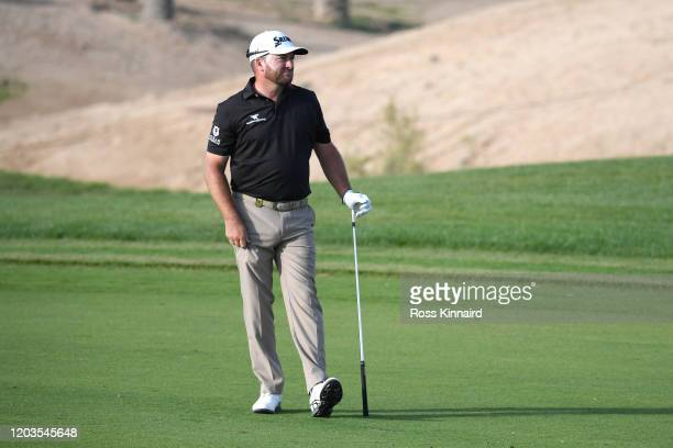 Graeme McDowell of Northern Ireland plays his second shot on the 18th hole during Day 4 of the Saudi International at Royal Greens Golf and Country...
